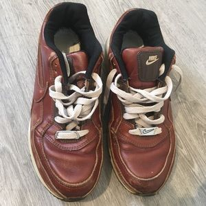 Nike air brown coloured size 8.5 sneakers.